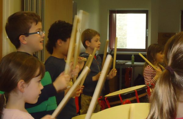 Picture of children engaged in the taiko workshop